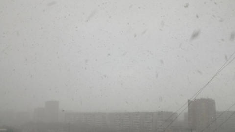 Aerial view of blizzard in urban city with buildings Footage