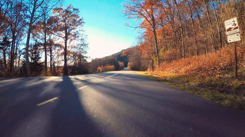 POV driving shot through the mountains in fall Live Action