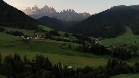 Aerial Drone video of Santa Magdalena St Maddalena Val di Funes in Dolomites Archivo