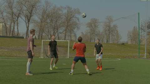 Soccer players training football in the pitch Footage