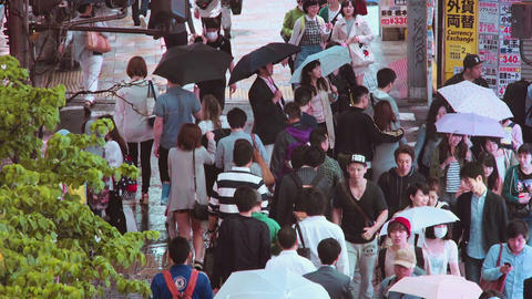 People walk down the street outside Shinjuku Station, Tokyo Footage