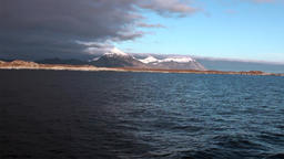Beautiful sunset on horizon on background of water of Arctic Ocean in Svalbard Footage
