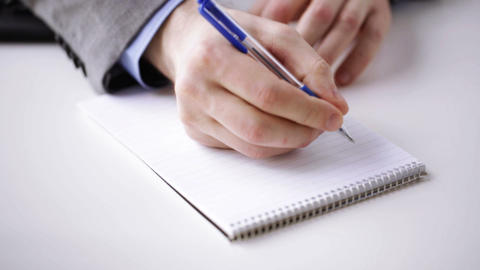 close up of businessman hand writing to notepad Footage