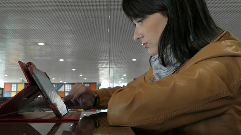Young Woman Using Tablet PC In Cafe Footage