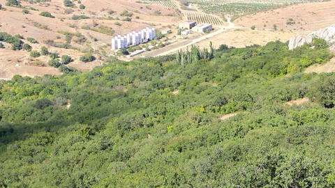 Factory processing of grapes in mountains. View mountain valley with vineyards Footage