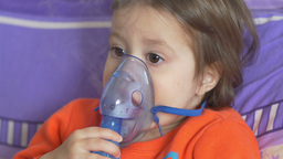 Child and Breath Nebulizer Footage