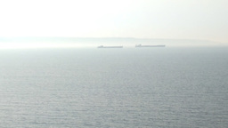 Ships are in Strait of sea, foggy day Live Action