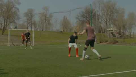 Football goalkeeper saving goal during match Footage