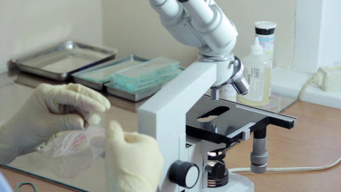 Doctor working In Lab With Microscope Footage