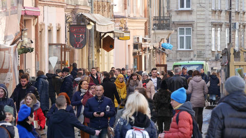 Ukraine, lviv - may 16: City pedestrian traffic shot on a busy lviv shopping Footage