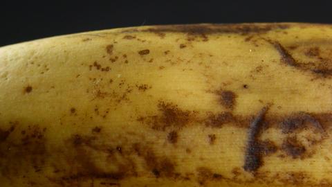 Banana skin extreme close up stock footage. Banana skin surface in macro close Live Action