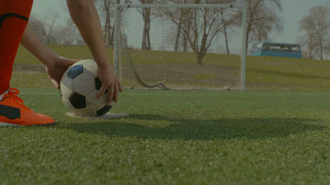 Soccer player executing penalty kick during training Live Action