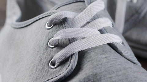Man casual boots details close-up - Male shoes laces and snitches slow tilting Footage