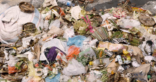 BALI, INDONESIA - CIRCA JAN 2018 - Close up of trash dumped next to a river Archivo