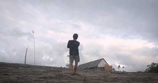 BALI, INDONESIA - CIRCA JAN 2018 - Man flying a stunt kite falls while Footage