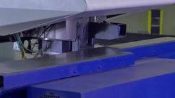Figured curly metal cutting on automated machine by robot Footage