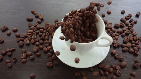 coffee beans splash falling into a cup Footage