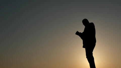 silhouette of man sending sms from smartphone Live Action