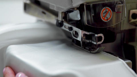 Close up on a sewing machine showing process Footage
