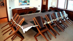 Chairs and table dining area on yacht passenger boat ship vessel Footage
