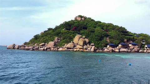 An island in fresh air with clear blue wavy sea background Live Action