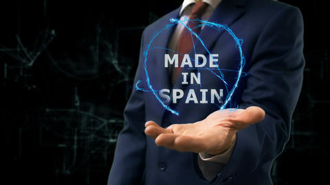 Businessman shows concept hologram Made in Spain on his hand Archivo
