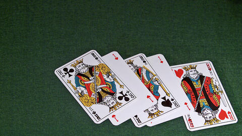 Playing Cards, Two Aces and Three Kings falling on Green Baize, Slow Motion Live Action