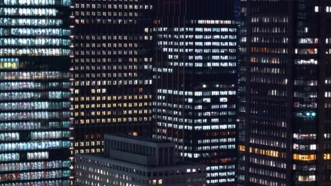 Tokyo skyscraper office buildings illuminated Footage