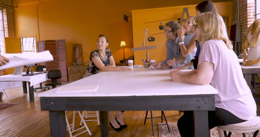 Latino man reveals new blue prints to his mostly female business associates for Footage