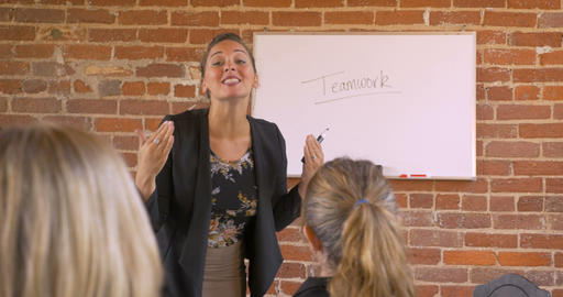Passionate female motivational speaker talking at a business seminar giving a Footage