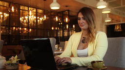 Business woman with long hair in business clothes typing on a mobile computer Footage