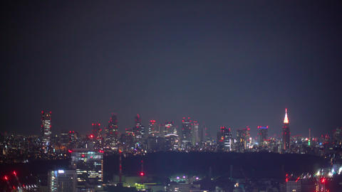The Shinjuku, Tokyo skyline illuminated at night Footage