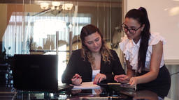 A business woman director signs the documents that the secretary brings to the Footage