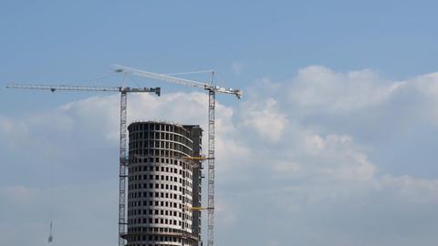 Skyscraper and cranes Stock Video Footage