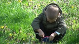 Young Boy Playing With Measuring Tape In The Backy stock footage