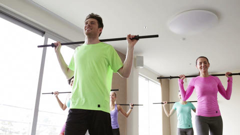 group of people exercising with bars in gym Footage