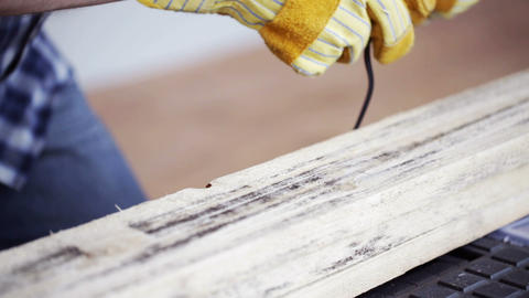 close up of man hammering nail to wooden board Footage