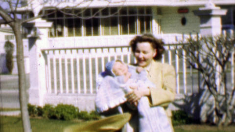 1957: Mother baby enjoying sunshine classic dining room supper club Footage