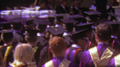 1964: Anxious college graduate crowd waiting to be awarded Footage
