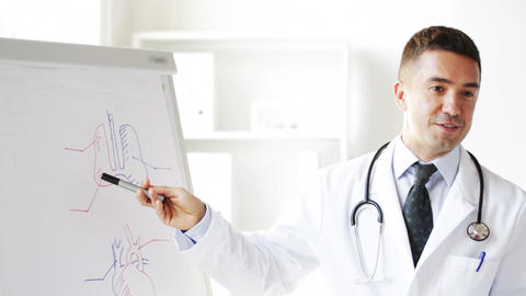 happy doctor showing medical drawing on flip board Footage