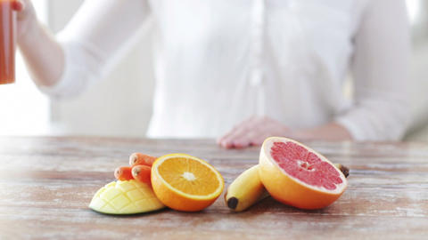 close up of woman hands with juice and fruits Footage