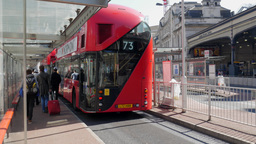 New Routemaster bus pulls into Victoria bus station in central London Footage