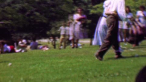 1957: 3 legged couples marriage counseling ball kicking cooperation game Footage