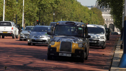 London Black Cabs speed along the Mall towards Buckingham Palace. Shot in 4K Footage