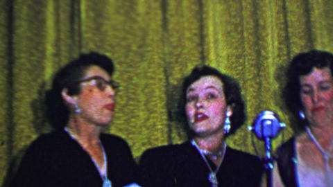 1957: Women trio singing old timey songs in matching shiny jewelry Footage