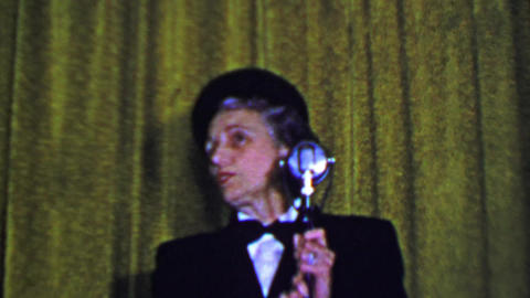 1957: Woman solo sarcastic comedy routine behind old microphone Footage