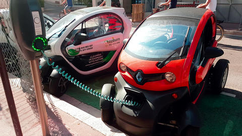 Renault Twizy Electric Car Charging On Street in Monaco Footage