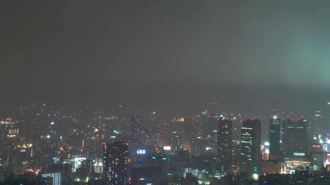 Time-lapse of rain over Osaka at night Footage