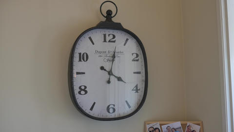 closeup shot of clock on wall GIF