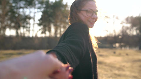 Follow me - happy young woman pulling guy's hand. Hand in... Stock Video Footage